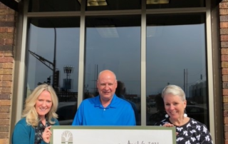 Roger's son, George Betz, along with Mindy Nuhring and Susan Lynch of the Community Foundation